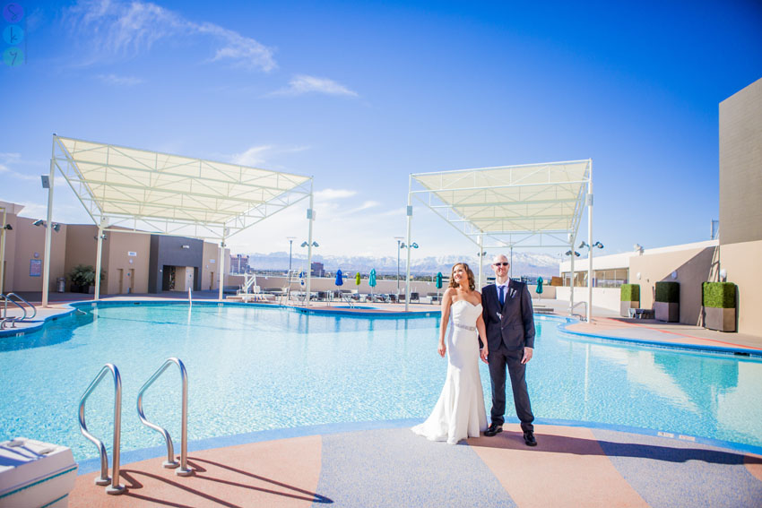 i took these stratosphere las vegas wedding photos by the pool with liz and brad on their wedding day